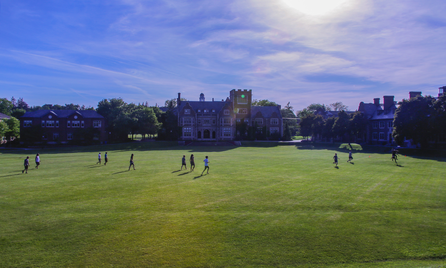 Students play a game of ultimate frisbee on the Quad.