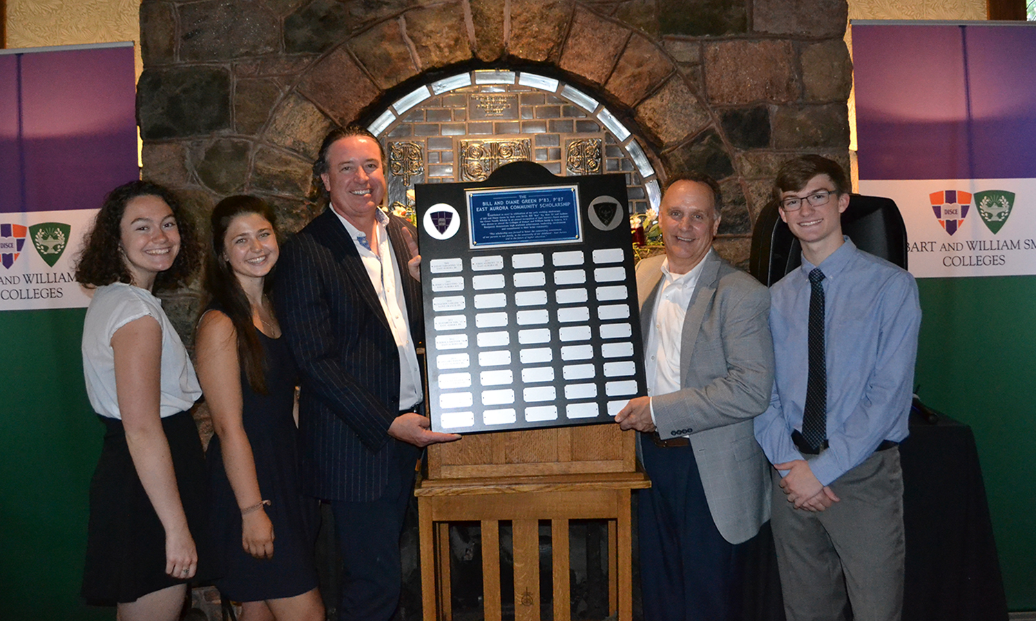 Wren G. Andrews '21, Teya R. Lucyshyn '19, William C. Green '83, CEO of the Boys and Girls Club of East Aurora Gary Schutrum and Jason W. Rose '22 pose for a photo during the Green Family Scholars reception at X.
