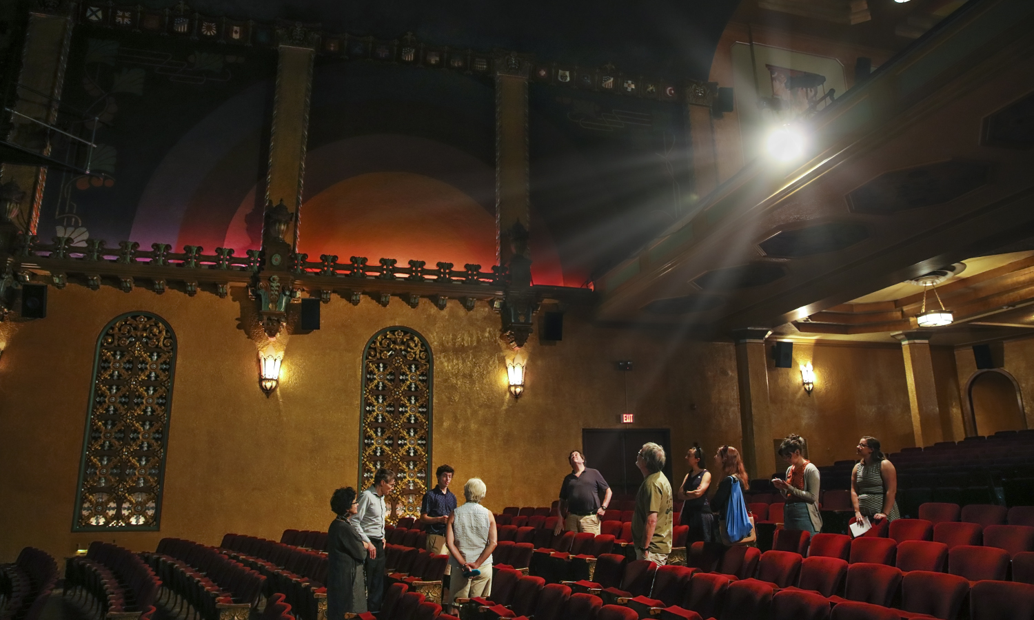 Austin Jennings 'X discusses the meaning behind the small flags lining the molding on the ceiling at the Smith Opera House.