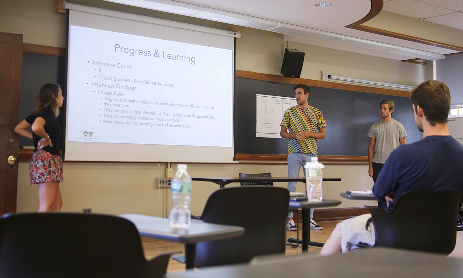 """X, Harrison Demaira '18 and Garrett Brzozowiec 'X present their initial findings. The three students are currenlty workshopping thier idea """"HD Social,"""" a social emdia advertising company."""