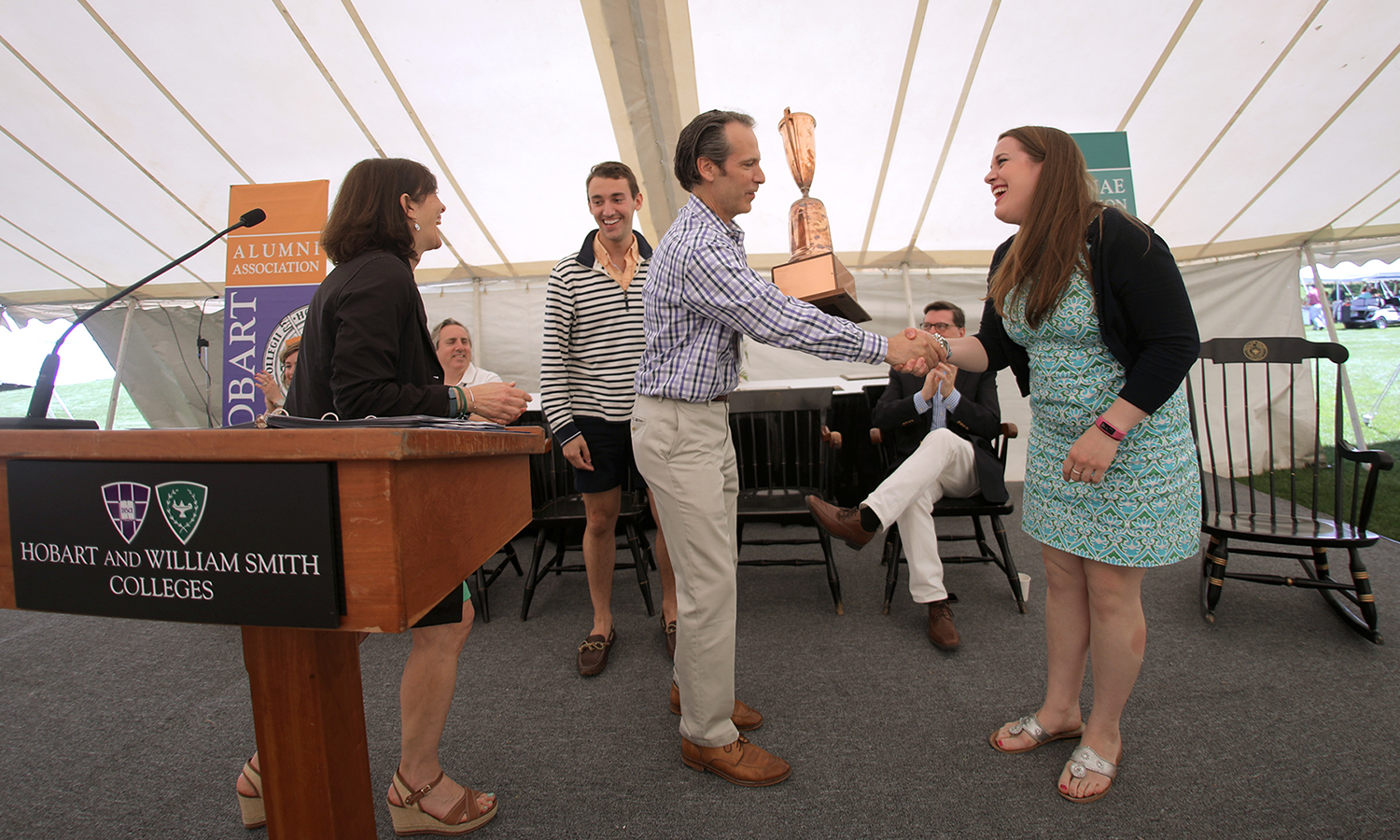 Meredith Ciaccia '12 recieves the Alumni and Alumnae Association participation trophy from Jared Weeden. The trophy is awarded to the class with the highest percentage attendance for the weekend.