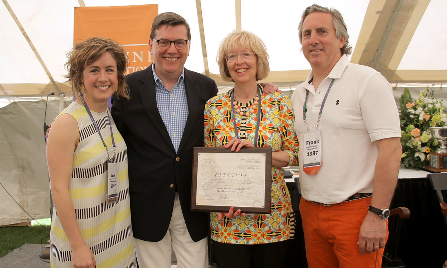 President Mark D. Gearan L.H.D. '17 and Mary Herlihy Gearan L.H.D. '17 are presented the Alumni and Alumnae association citation for service by Jane Erickson '07 and Frank Aloise Jr. '87.  The citation is awarded for generous service to generations of students and alums.