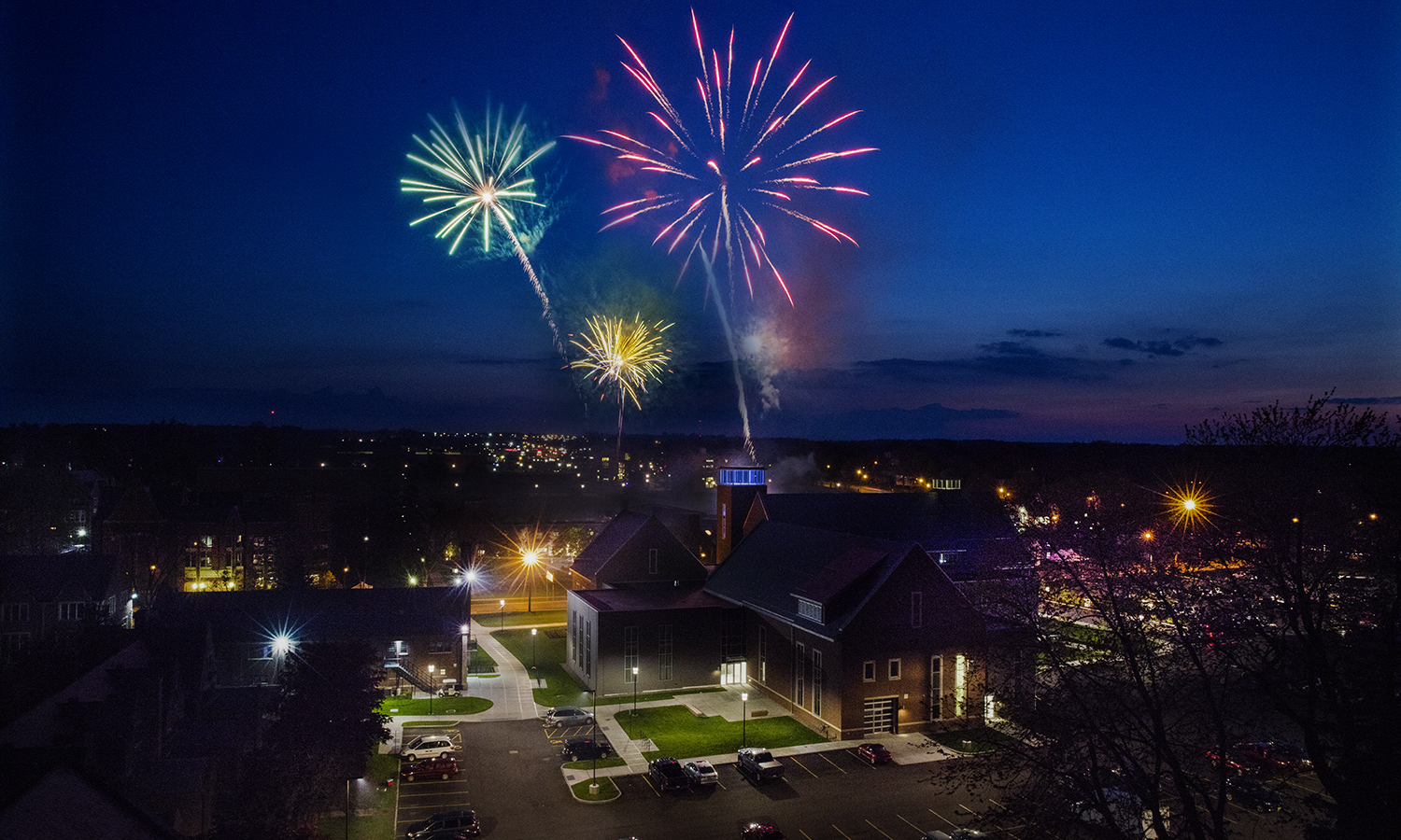 Fireworks fill the sky over the Gearan Center for the Performing Arts during the Senior Barbecue for the Classes of 2016.