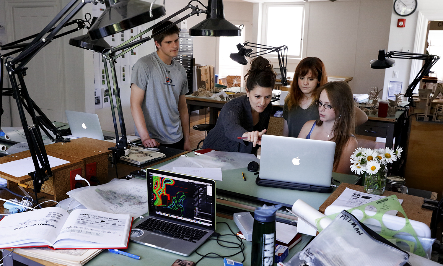 Assistant Professor of Architectural Studies Gabriella D'Angelo instructs students on how to use AutoCAD to transfer their hand drawn designs to the computer. J.P. White '17, Audrey English '17, Sarah Pullman '18 and Garth Burke '17 (not pictured) are creating landscape designs for the area around the new Richard S. Perkin Observatory.