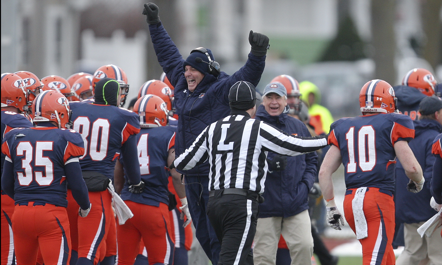 Hobart Head Football Coach Mike Cragg celebrates after a touchdown.