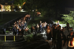 Students march silently across campus as part of the Black Lives Matter candlelight vigil.