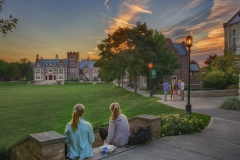 Students enjoy beautiful skies and fall weather on the Quad.