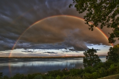 A rainbow stretches over Seneca Lake. The photo was taken from the benches on South Main Street.