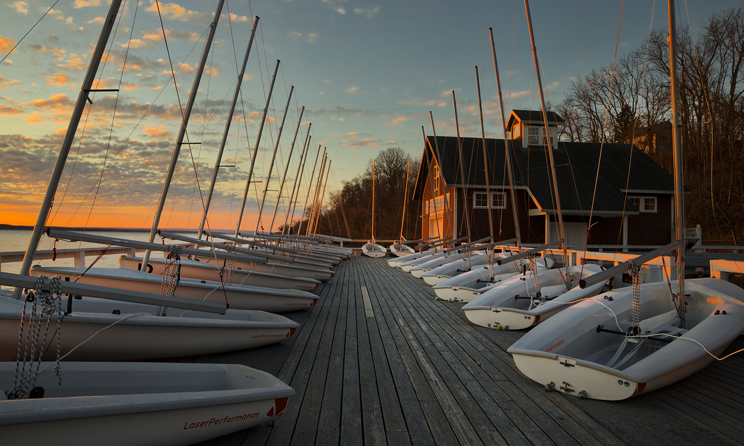The sun rises over Bozzuto Boathouse.
