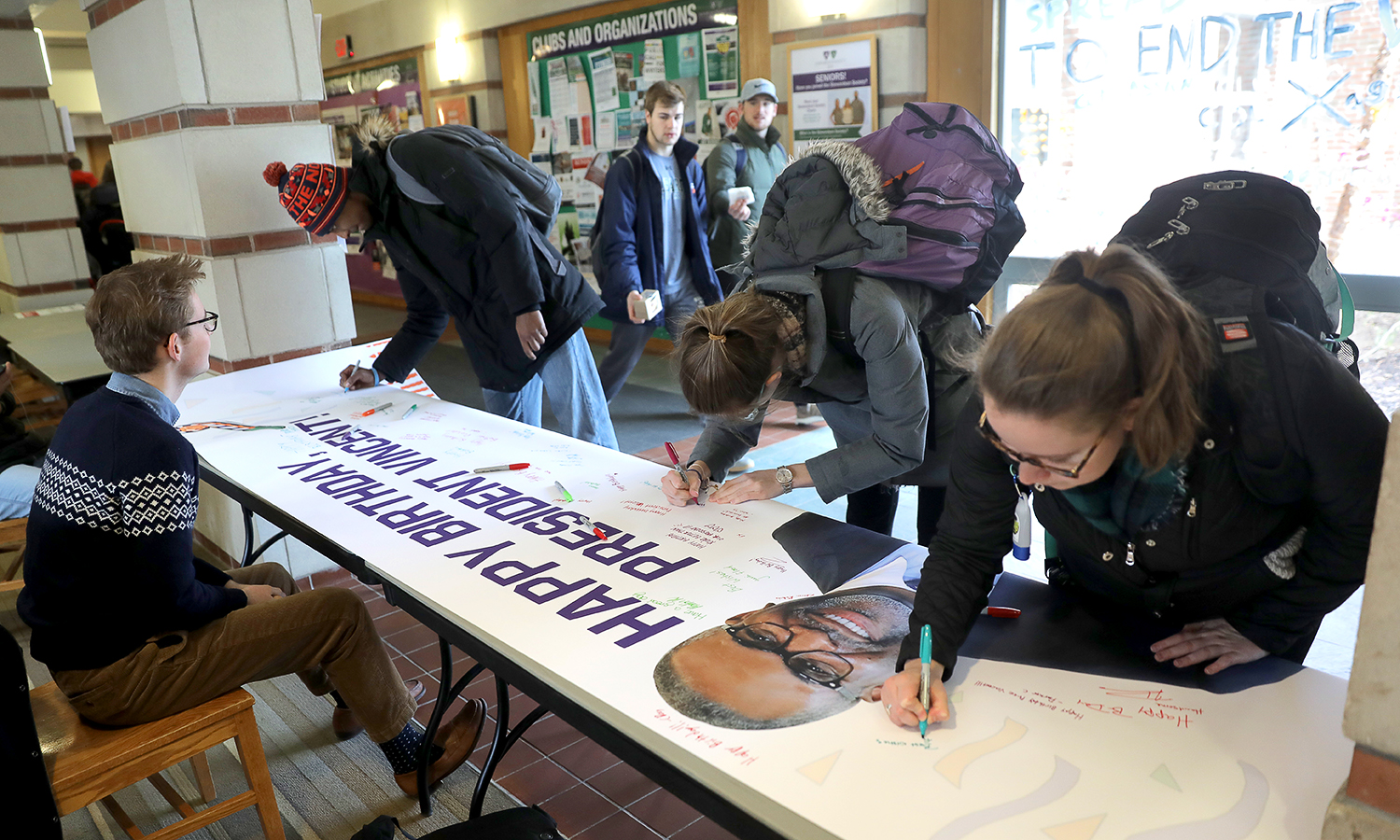 In Scandling Campus Center, students sign a banner for President Gregory J. VIncent '83 in celebration of his birthday on Sunday.