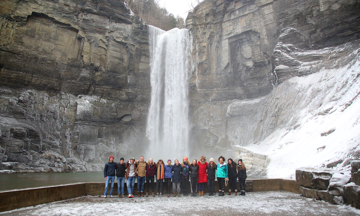 Members of the HWS Outdoor Recreation Adventure Program take a group photo at Taughannock Falls State Park in Ulysses, NY.