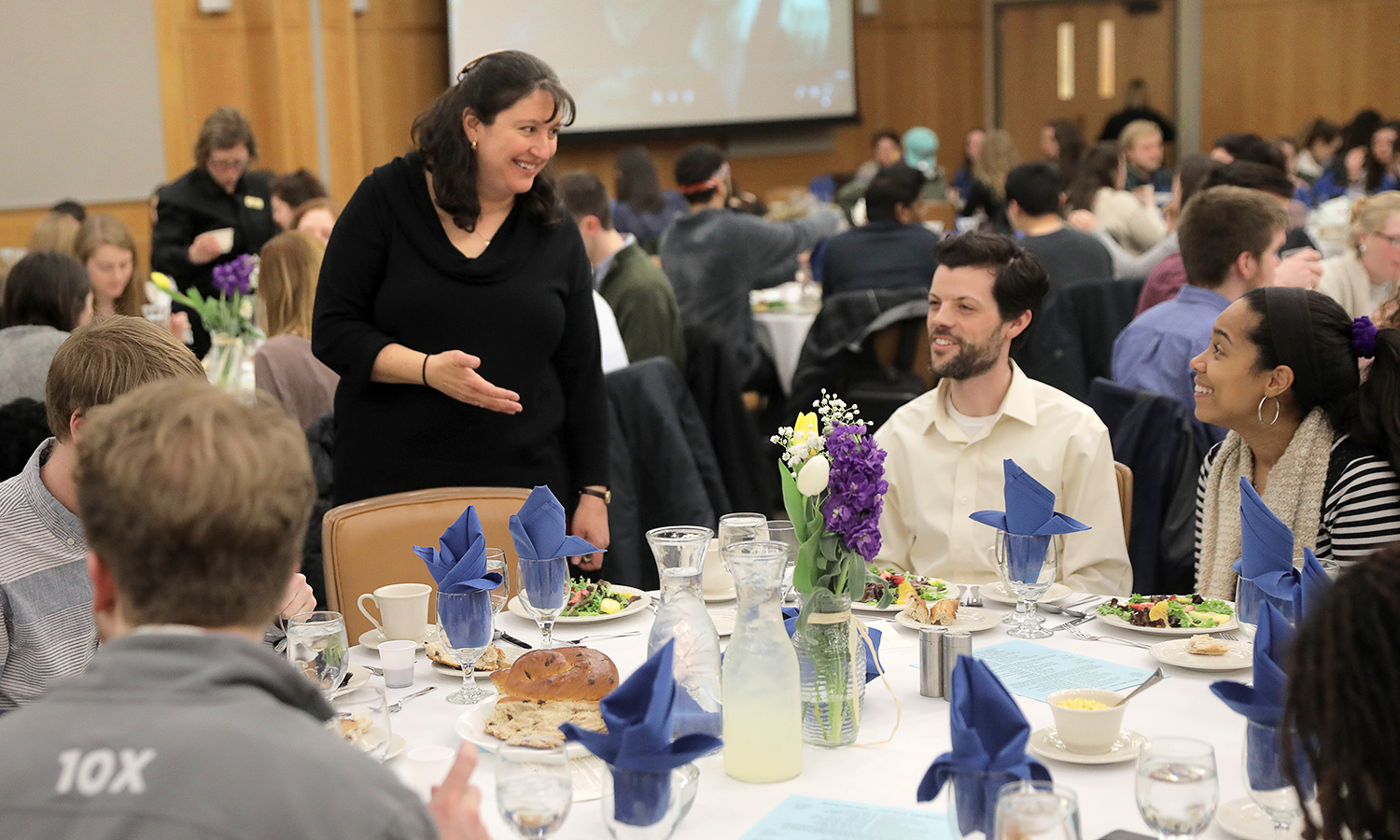 Director of the Abbe Center for Jewish Life and HWS Hillel Advisor Julianne Miller chats with Associate Director of the Center for Community Engagement and Service Learning Jeremy Wattles and Assistant Director of the Office of Intercultural Affairs Darline Polanco Wattles '09 during HWS Shabbat dinner.