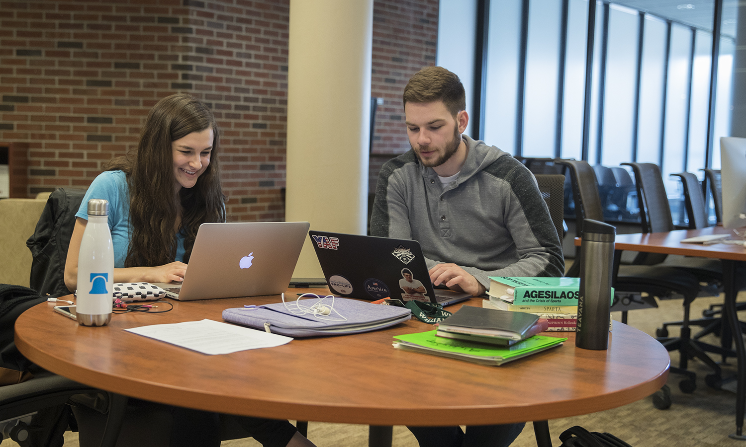 Katrina Willis '18 and Nick Haydon '18 work on thier honors projects on the first floor of Warren Hunting Smith Library.