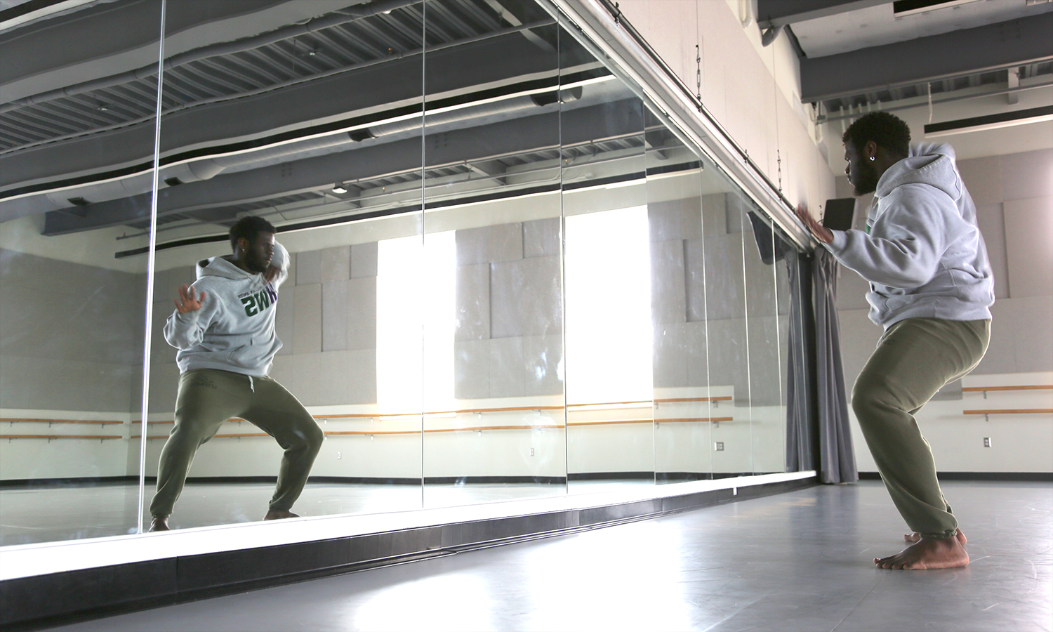 """Jedidiah Collins '18 practices dance steps in the Robert A. Bristol '31 Field House. Collins is a member of the HWS step dance team """"Hip~NotiQs."""""""