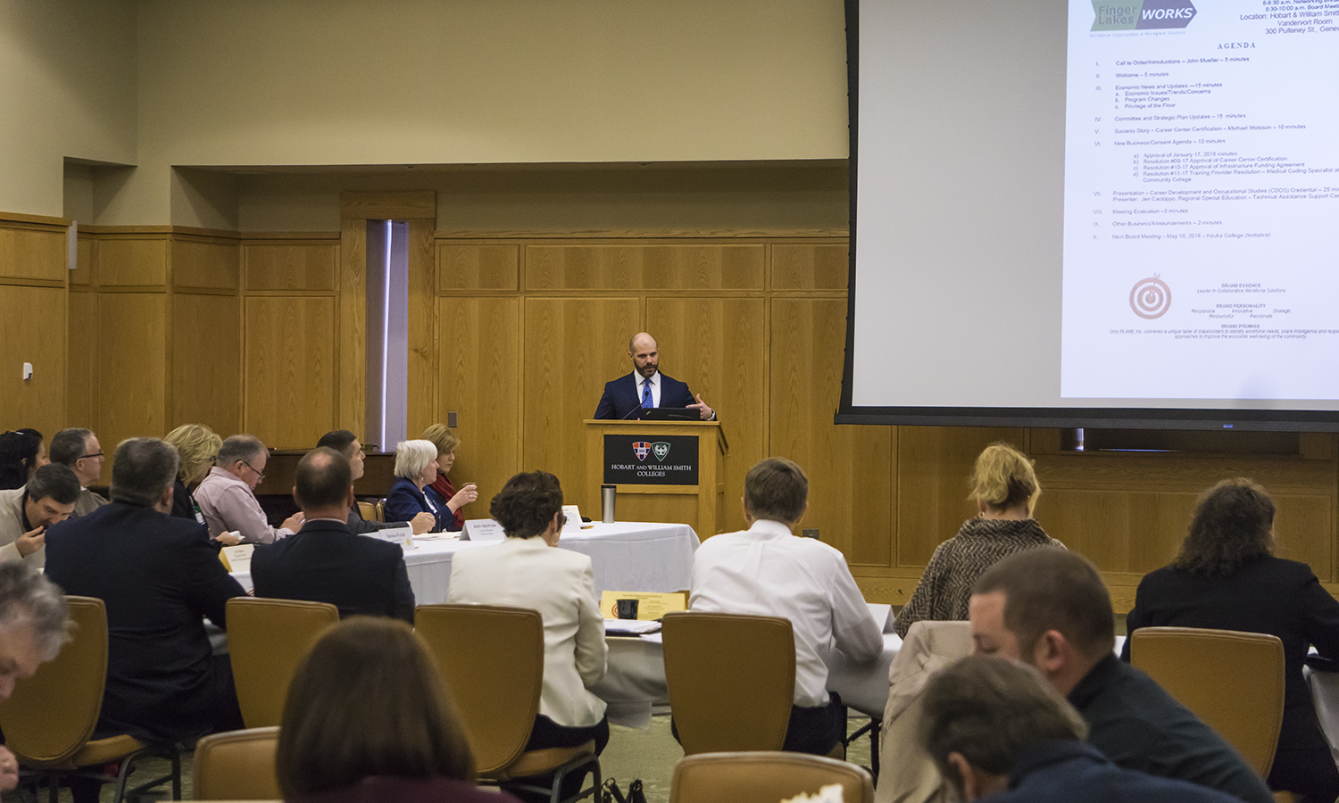 Vice President and General Counsel Louis H. Guard '07 welcomes Geneva community members for the FL Workforce Development Board of Directors meeting in the Vandervort Room.