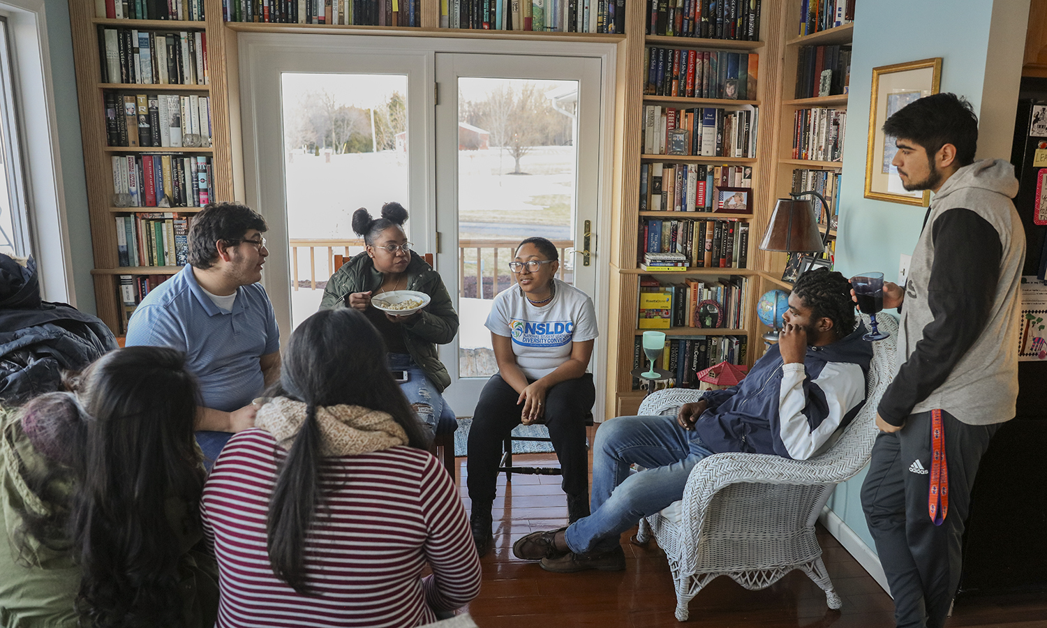 Members of the HWS Posse program enjoy dinner at the home of Posse 5 Mentor and Director of Campus Safety Marty Corbett during Spring Break.