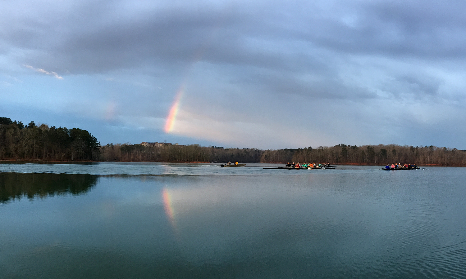 The William Smith Rowing Team rows by a rainbow during Spring Break training in Clemson, South Carolina.