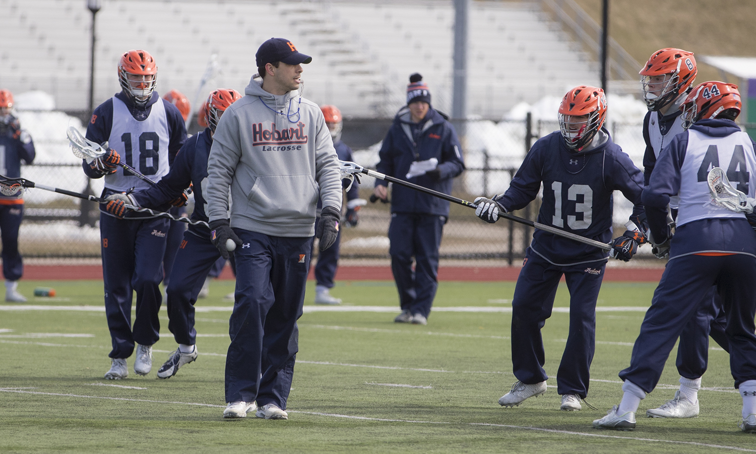 Hobart Lacrosse Head Coach Greg Raymond runs a practice on Boswell Field on Tuesday.
