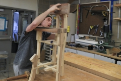 Zach Felder â18 puts the finishing touches on a stool for guitar playing as part of âFurniture Designâ with   Visiting Assistant Professor of Art and Architecture Patrick Kana '12.