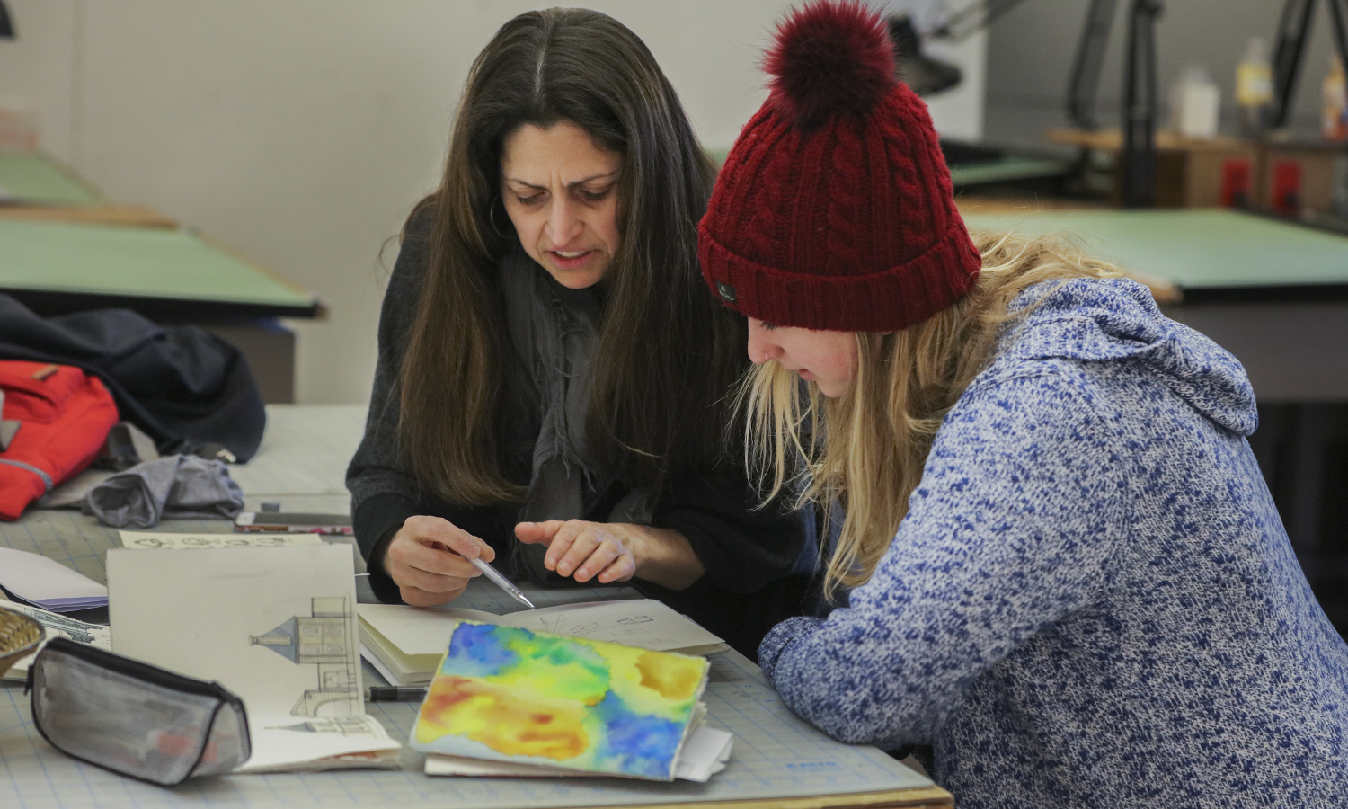 "Associate Professor of Art and ArchitectureKirin Makker works on an assignment with Alyda Twilley 20 during ""Watercolor Sketching"" in Houghton House."