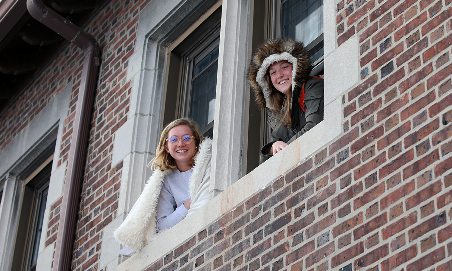 Cailin Gensler '21 and Katie Cox '20 enjoy a little fresh air outside of Medbury Hall.