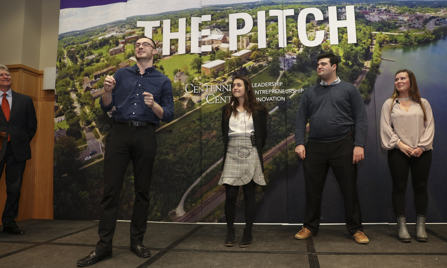 "While the judges deliberate, four students present their ""Flash Pitch,"" a ninety-second pitch for a product or service. In the photo above, the audience-selected winner of the competition Cort Williams '19 presents ""SkyHigh."""
