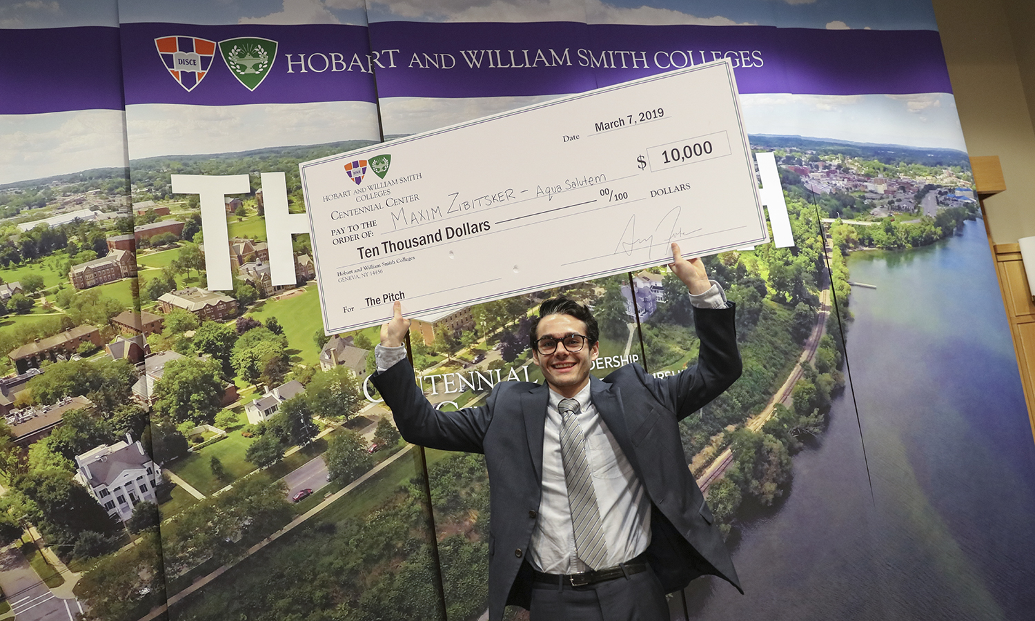 The 2019 winner of the Pitch contest Maxim Zibitsker '19 poses with the $10,000 check. Zibitsker also competed in the finals of 2017 Pitch contest. Since then, he declared an entrepreneurial studies minor at the Colleges, began a mentorship with Visiting Assistant of Entrepreneurial Studies Craig Talmage and pivoted his idea to helping homeowners improve their pool safety.