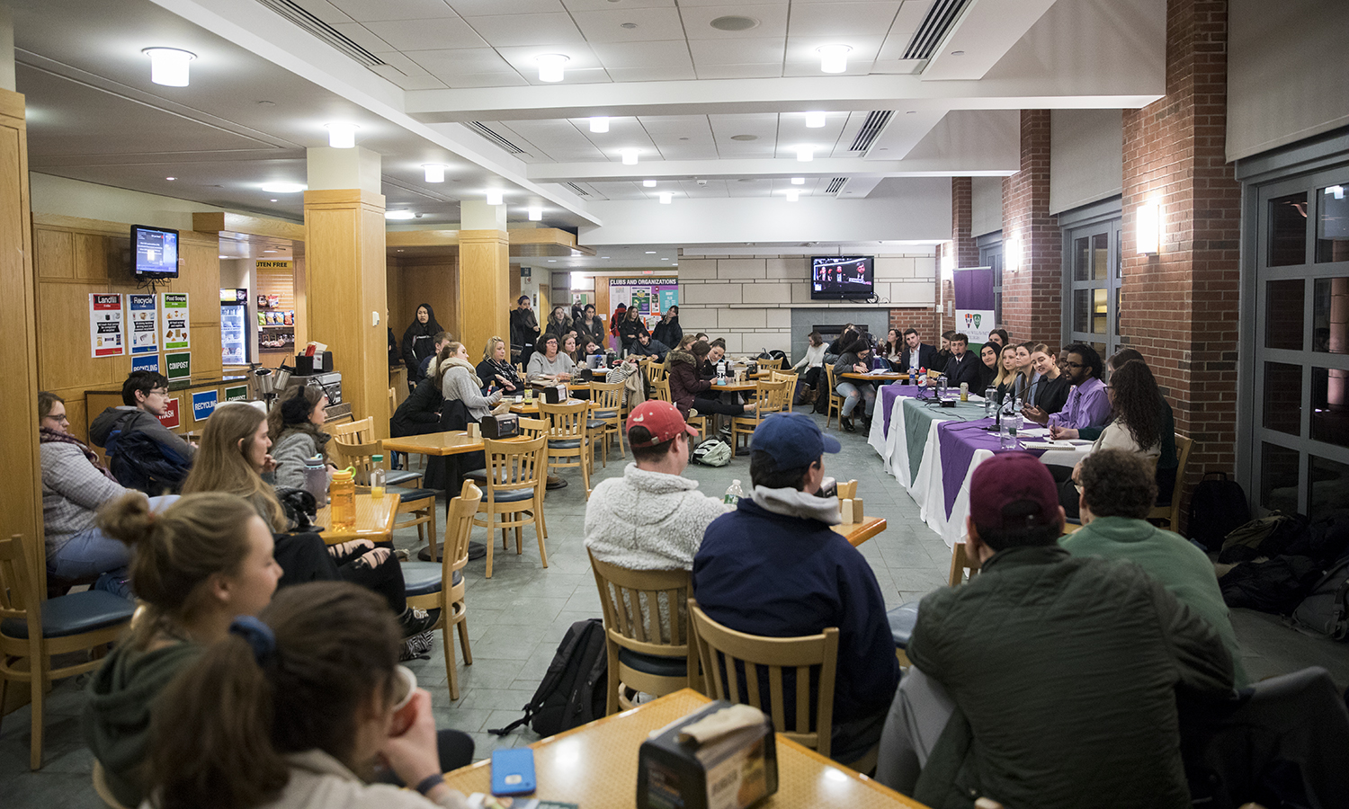 Students fill the Scandling Center Café for the Student Trustee Debate on Tuesday.