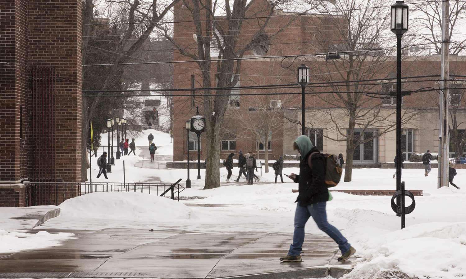 Students walk to class on a snowy Thursday afternoon.