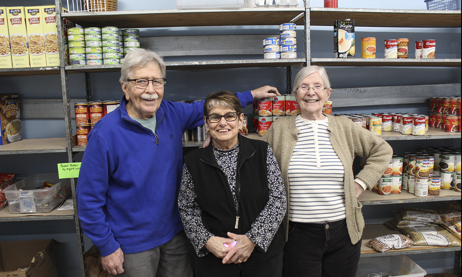 HWS Professor Emeritus of English James Crenner and community members Linda Beckley and Sue Garver stop for a photo while volunteering at the Center of Concern on Tuesday morning. Professor Emeritus of Biology Thomas Glover serves as the president of the Center's board of directors.