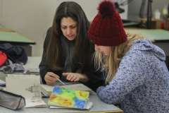 Associate Professor of Art and ArchitectureKirin Makker works on an assignment with Alyda Twilley 20 during âWatercolor Sketchingâ in Houghton House.