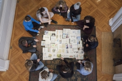 Studentsreview thier work during âWatercolor Sketchingâ with Associate Professor of Art and Architecture Kirin Makker.