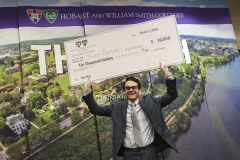 The 2019 winner of the Pitch contest Maxim Zibitsker â19 poses with the $10,000 check. Zibitsker also competed in the finals of 2017 Pitch contest. Since then, he declared an entrepreneurial studies minor at the Colleges, began a mentorship with Visiting Assistant of Entrepreneurial Studies Craig Talmage and pivoted his idea to helping homeowners improve their pool safety.