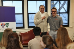 Professor of History Chip Capraro introduces Drew Blanchard '21 during the Writing Colleagues Welcome Reception.