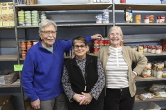 HWS Professor Emeritus of English James Crenner and community members Linda Beckley and Sue Garver stop for a photo while volunteering at the Center of Concern on Tuesday morning. Professor Emeritus of Biology Thomas Glover serves as the president of the Centerâs board of directors.