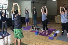 Associate Professor of English Laurence Erussard and Associate Professor of Psychology Julie Kingery join students for yoga class on Saturday morning in Hirshson Ballroom.