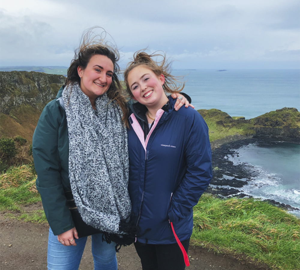 After hiking up a cliff side, Sophie Kaufman '20 and Bennett Tierney '20 stand over the Giant's Causeway below them in Northern Ireland.  The Galway, Ireland study abroad program is being led this semester by Professor of English, Anna Creadick.