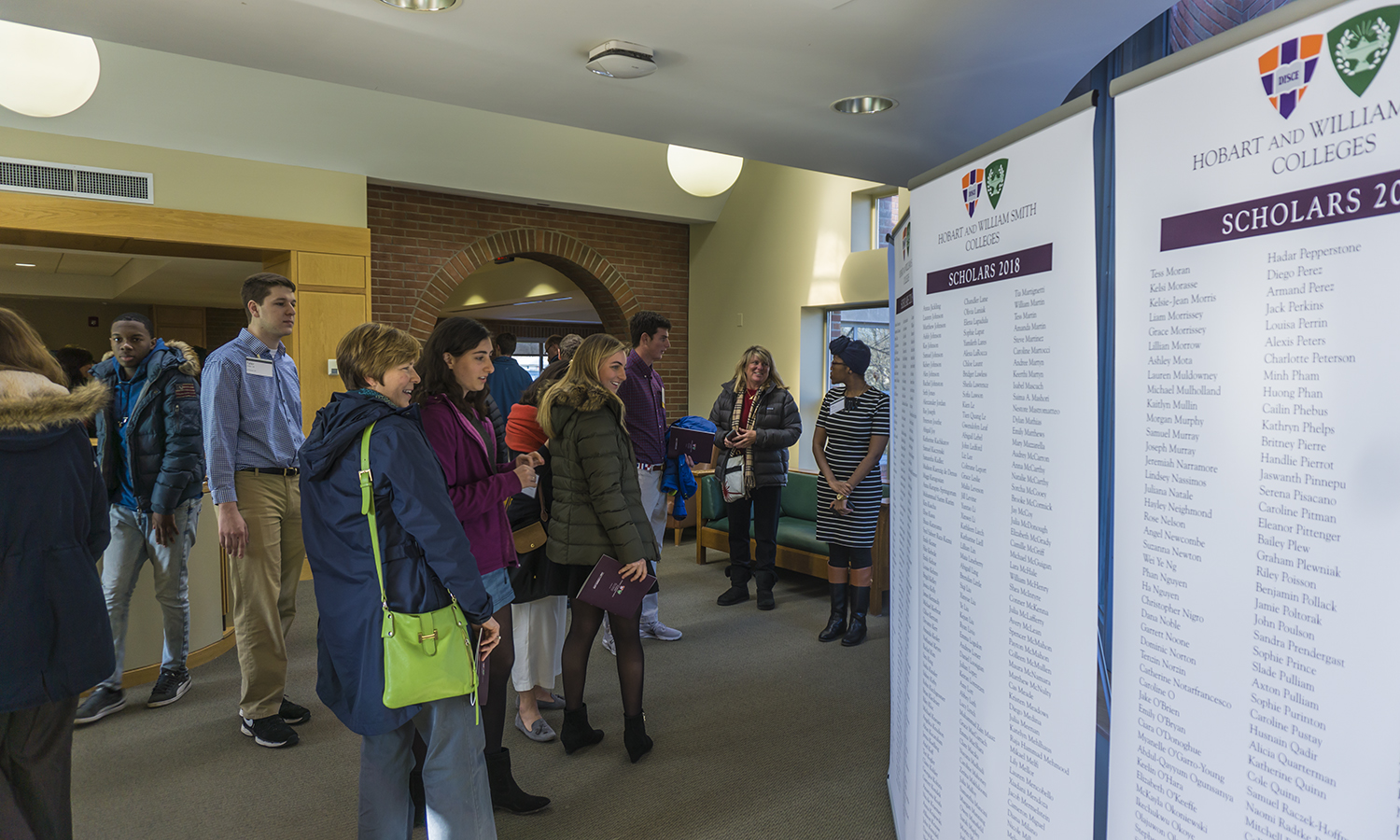 Prospective students check out thier names on display following the HWS Scholar Day dinner.