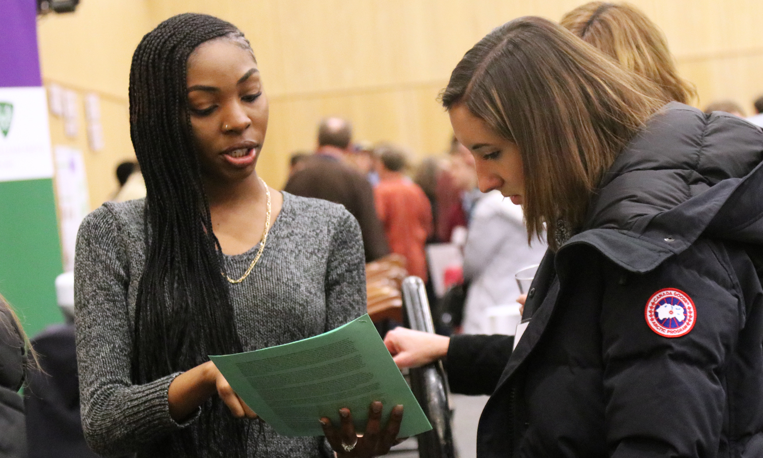 Canieshia Phillips '19 talks with a prospective student about majoring in Writing and Rhetoric as part of the academic fair during HWS Scholar Day.