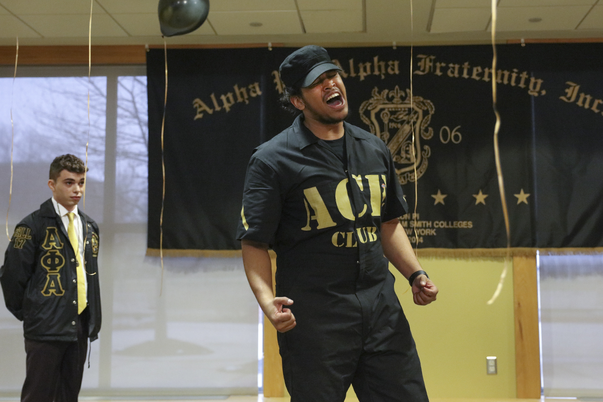 Eros Cabrera '19 dances during his intiation to the HWS chapter of the Alpha Phi Alpha Fraternity in Scandling Campus Center.