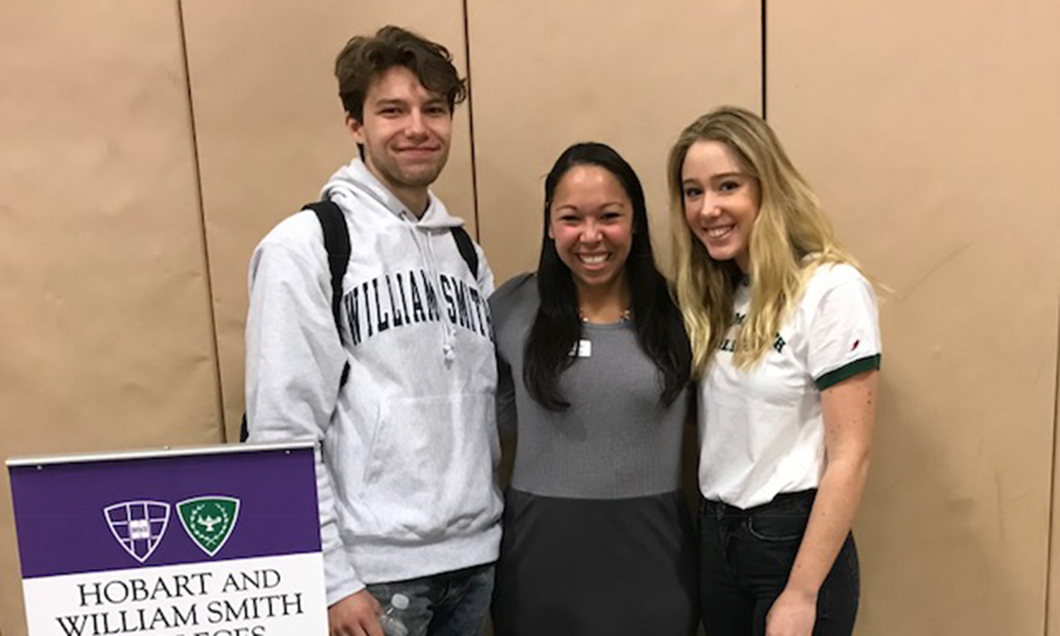 Prospective students Will and Marie Ostrand '22 gather for a photo with 	Associate Director of Admissions Brianne Ellis at Darien High School in Darien, CT.