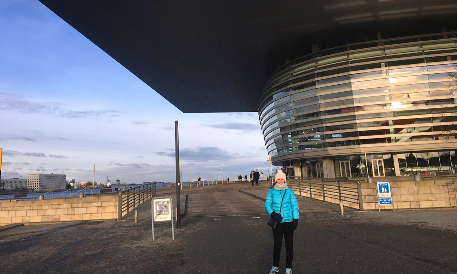 Erika Ireland '19 poses in front of the Copenhagen Opera House in Copenhagen, Denmark as part of her Student International Initative Fund grant given by the Center for Global Education.