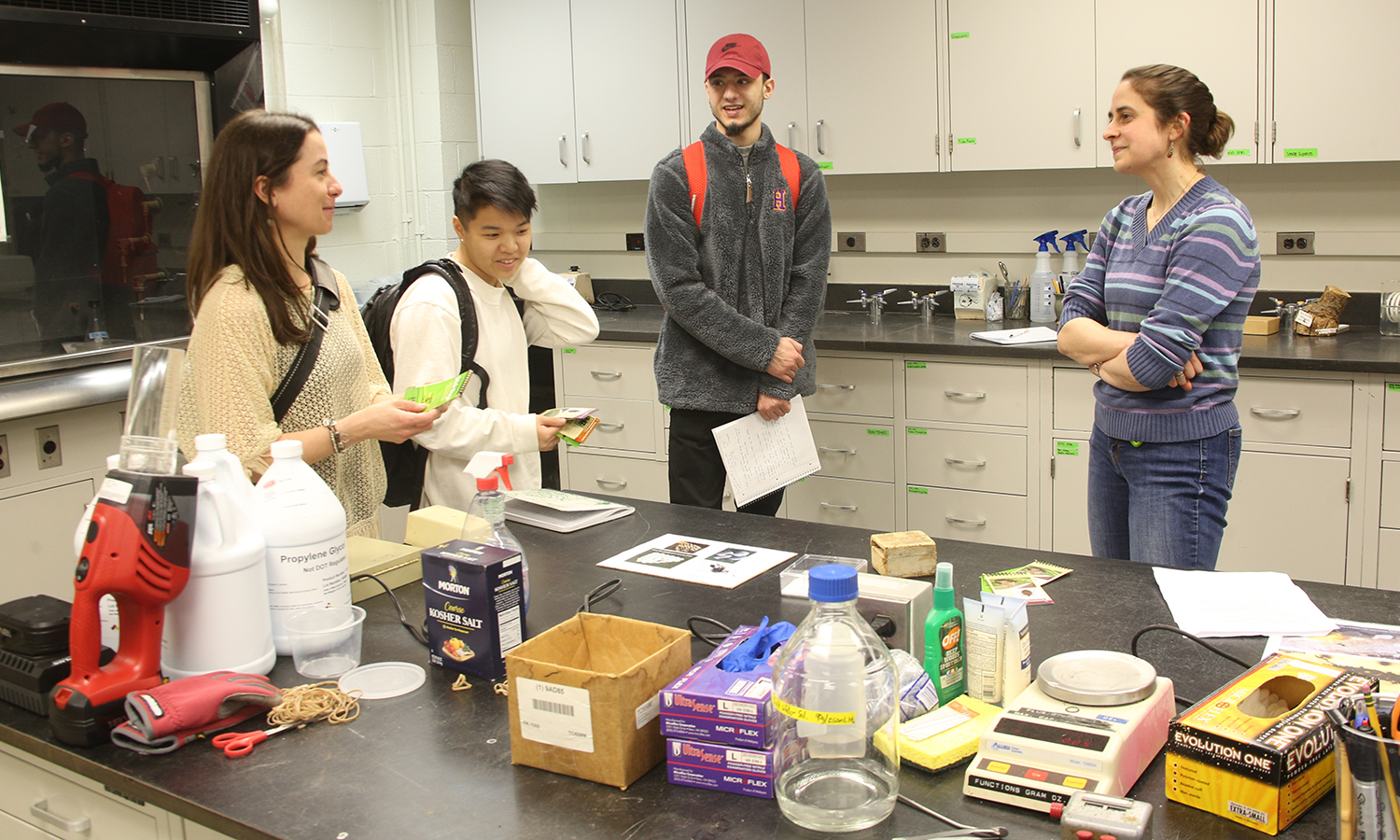 Associate Professor of Biology Meghan Brown, Dev Davis '18, Nimer Farhood '18 and