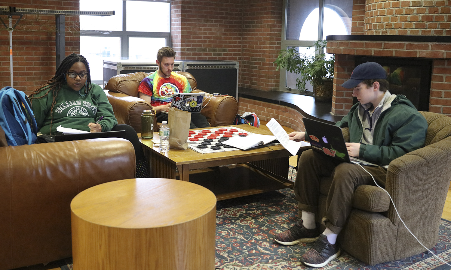 """Bernice """"BB"""" Shed '20, Parker Cornman '20 and Harry Spencer '21 work in the lounge in Scandling Campus Center."""