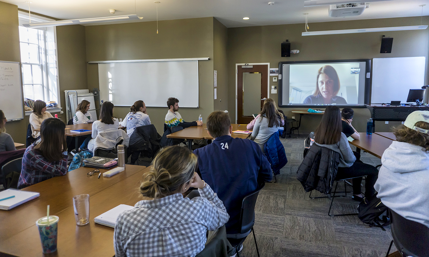 """Journalist Jill Craig discusses sex work and sex trafficking in Africa during a video conference with students in """"Social Deviance"""" with Associate Professor of Sociology James Sutton."""