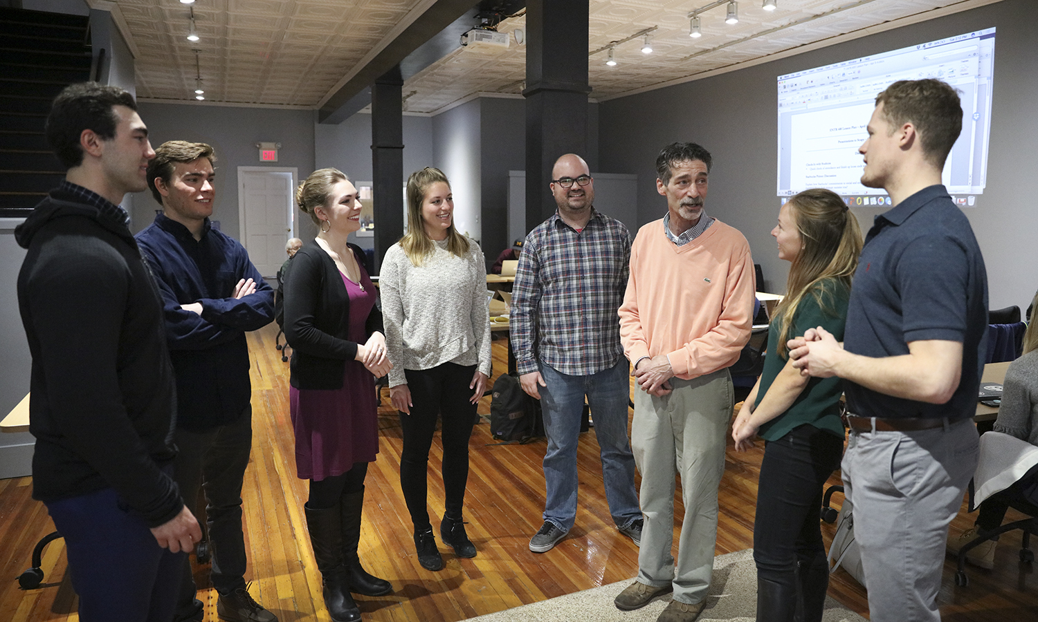 Students talk with Visiting Assistant Professor of Entrepreneurial Studies Craig Talmage and Richard Madia following thier senior capstone course in the Bozzuto Center for Entrepreneurship.
