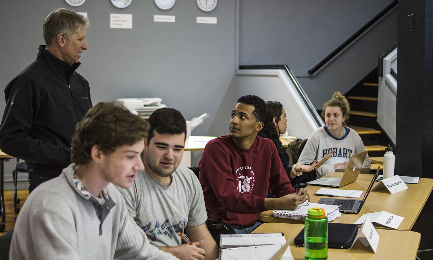 """Margiloff Family Entrepreneurial Fellow Ed Bizari discusses helps Kwame Morris 'X workshop his idea for a medical transportation service as part of the """"Discovery Lab"""" in the Bozzuto Center for Entrepreneurship."""
