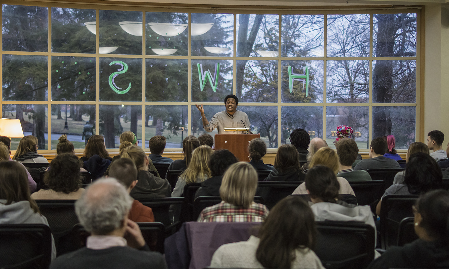 """Poet Danez Smith delivers a reading from their new book """"Don't Call Us Dead"""" in the Hirshson Ballroom on Thursday. The event was sponsored by the Trias Residency for Writers."""