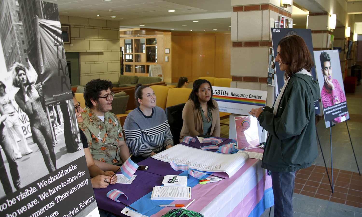 In Scandling Campus Center, Divaya Tewari '18, Kevin Cervantes 'X, Alexa Holmes 'X and Stephanie Pichardo 'X talk with Banan Otaibi '18 while tabling on behalf of of the LGBTQ+ Resource Center during Transgender Day of Visibility.