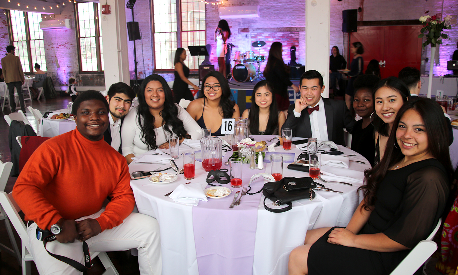 Students gather for a photo during the Caribbean Student Association's annual Masquerade Ball at the Cracker Factory.